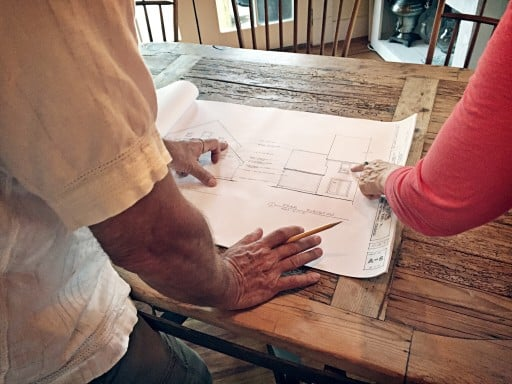 Architect Discussing House Plans